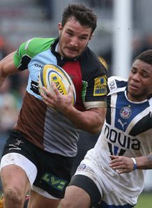 George Lowe of Harlequins races away from Kyle Eastmond of Bath