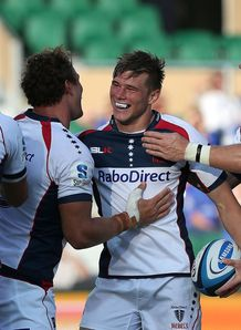 Jason Woodward of the Rebels celebrates after scoring a try