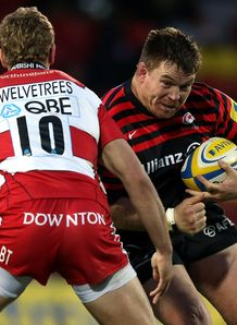 John Smit of Saracens takes on Billy Twelvetrees of Gloucester