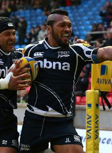 Johnny Leota of Sale Sharks celebrates with Sam Tuitupou after scoring
