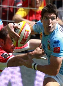 Perpignan s fly half James Hook is tackled by Biarritz