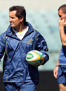 Robbie Deans with Quade Cooper in background