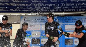 Sir Bradley Wiggins led the celebrations on the podium