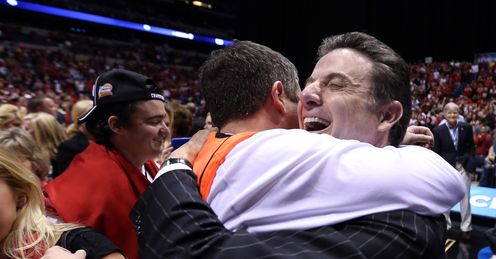 Pitino (right) celebrates Louisville's victory over Duke