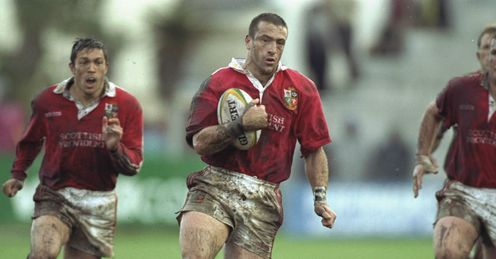 1997 - John Bentley of the British Lions runs with the ball with his team mates in support during the match against Border