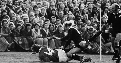 1977 - JJ Williams of the British Lions dives past New Zealands Grant Batty to score in the second Test