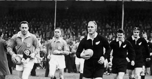 1959 - British Lions captain Ronnie Dawson left and All Blacks captain Wilson Whineray lead out their teams before the start of the rugby first Test at Dunedin