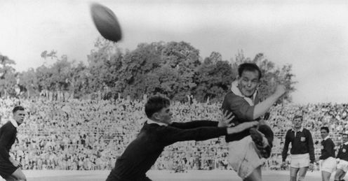 1962 - Junior Springbok Brian Harrison tries to prevent British Lions scrum-half Dickie Jeeps kicking the ball during a game in Pretoria