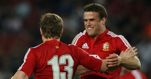 2009 - Brian ODriscoll of the British and Irish Lions is congratulated by team mate Jamie Roberts against the Golden Lions