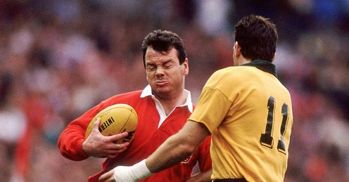 1989 - Ieuan Evans of British Lions charges into David Campese right of Australia