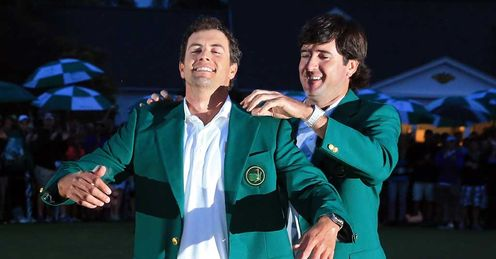 Adam Scott receives the coveted green jacket
