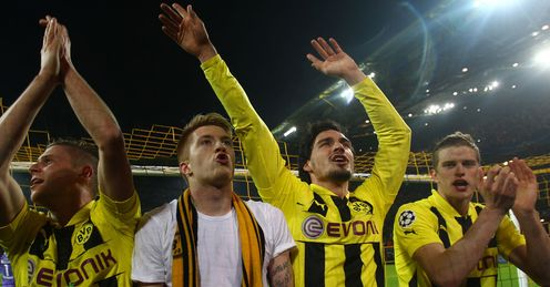 Dortmund's Piszczek, Reus, Hummels and Gundogan interact with the fans