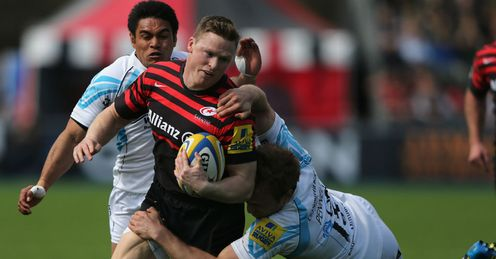 Chris Ashton of Saracens is tackled by Chris Pennel of Worcester