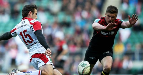 Jared Payne of Ulster attempts to clear the ball under pressure from Owen Farrell of Saracens