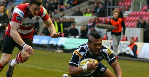 Johnny Leota of Sale Sharks dives over the line to score the opening tr