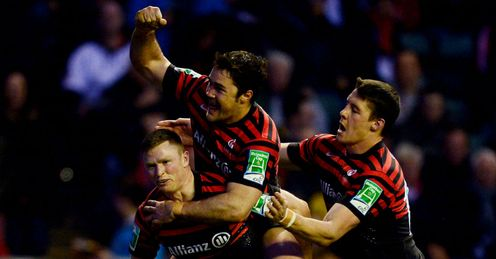 Wing Chris Ashton of Saracens is congratulated by teammate Brad Barritt C and Joel Tomkins