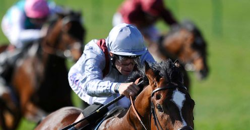 Richard Hughes riding Toronado wins at Newmarket racecourse on April