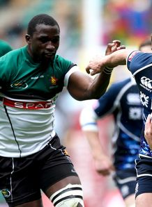 Lee Jones of Scotland hands off the tackle of Daniel Hondo of Zimbabwe london sevens