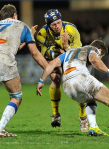 Clermont s French flanker Julien Bonnaire is tackled v Castres