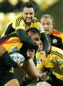 Tim Bateman tackling Ben Afeaki in Hurricanes v Chiefs game