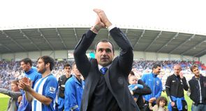 Martinez to hold Wigan talks