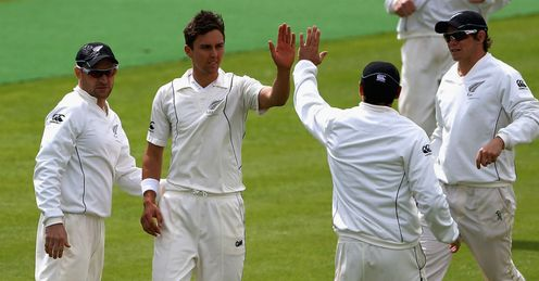 Doug Bracewell of New Zealand is congratulated on bowling Joe Root of England Lions
