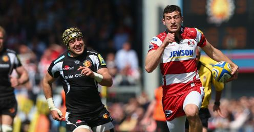 Jonny May R of Gloucester bursts past Jack Nowell C of Exeter Chiefs