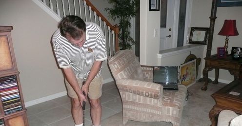 Simon tries out the Palmbird putter in his Orlando living room