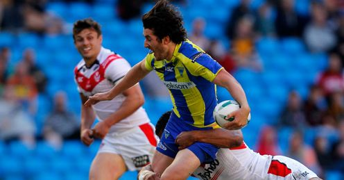 Stefan Ratchford C of Warrington is tackled by Sia Soliola
