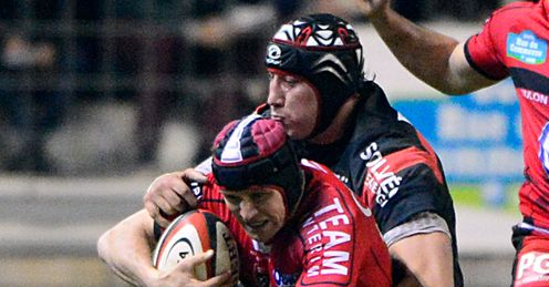 Toulon Matt Giteau L is tackled by Toulouse lock Patricio Albacete