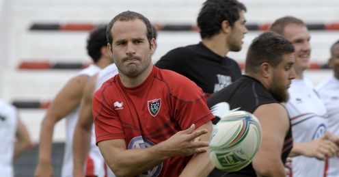 Toulon s scrum half Frederic Michalak passes during a training session