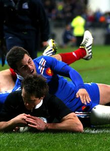 Ben Smith of the All Blacks scores a try despite the tackle of Brice Dulin of France