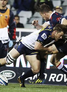 Brumbies wing Clyde Rathbone making a tackle