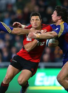 Dan Carter of the Crusaders is tackled v Highlanders