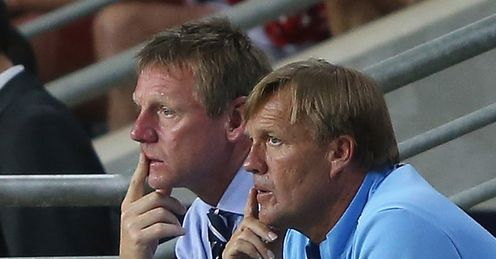 Problems: Stuart Pearce and Steve Wigley watch England lose to Norway