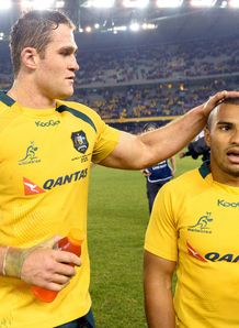 Australian Wallabies captain James Horwill L pats halfback Will Genia