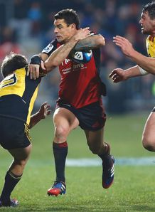 Dan Carter of The Crusaders is tacled The Hurricanes