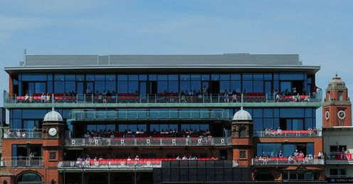Old Trafford: sheeting, rather than seating, behind the bowler's arm