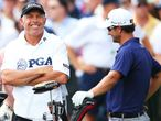 Steve Williams (L) and Adam Scott (R) share a joke.