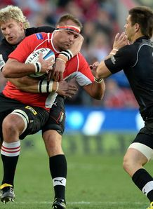 Hendrik Roodt of the Lions gets tackled v Kings