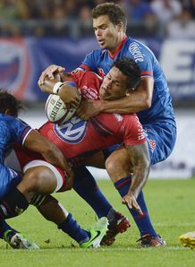 Toulon wing David Smith C is tackled by Grenoble