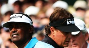 Vijay Singh and Phil Mickelson cross paths at the first hole on Saturday