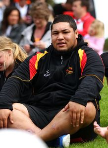 Ben Tameifuna sitting down
