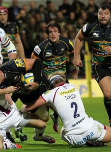 Northampton v Sale Sam Dickinson tackled by Tommy Taylor