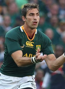 Ruan Pienaar of South Africa passes the ball