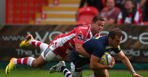 Andy Forsyth of Sale Sharks scores his sides second try despite the efforts of Henry Trinder of Gloucester