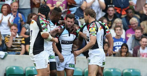 Karl Dickson C of Harlequins celebrates with team mates after scoring the match winning try