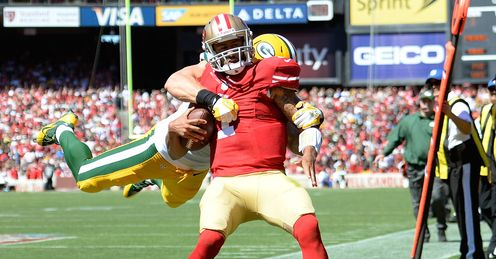 Clay Matthews of the Green Bay Packers tackles Colin Kaepernick of the San Francisco 49ers