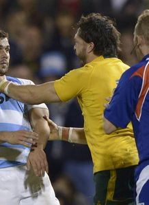 Australia Adam Ashley Cooper grabs Argentina scrum half Martin Landajo