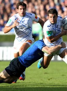 Castres s Brice Dulin tackled v Leinster